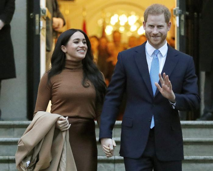 Britain's Prince Harry and Meghan, Duchess of Sussex leave after visiting Canada House in London.