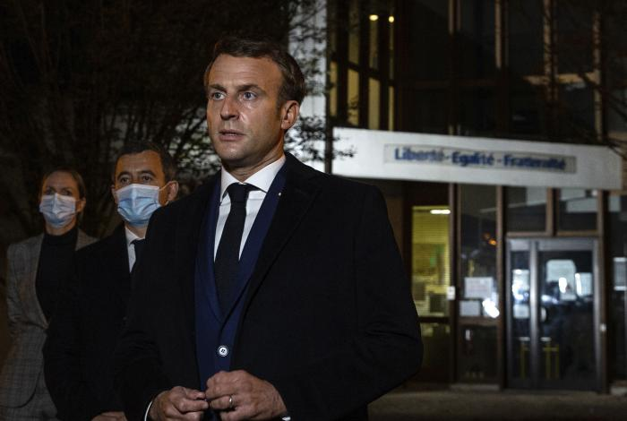French President Emmanuel Macron speaks in front of a high school Friday Oct.16, 2020 in Conflans Sainte-Honorine, northwest of Paris