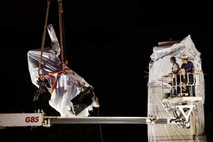 A work crew removes the Columbus statue in Grant Park in Chicago.