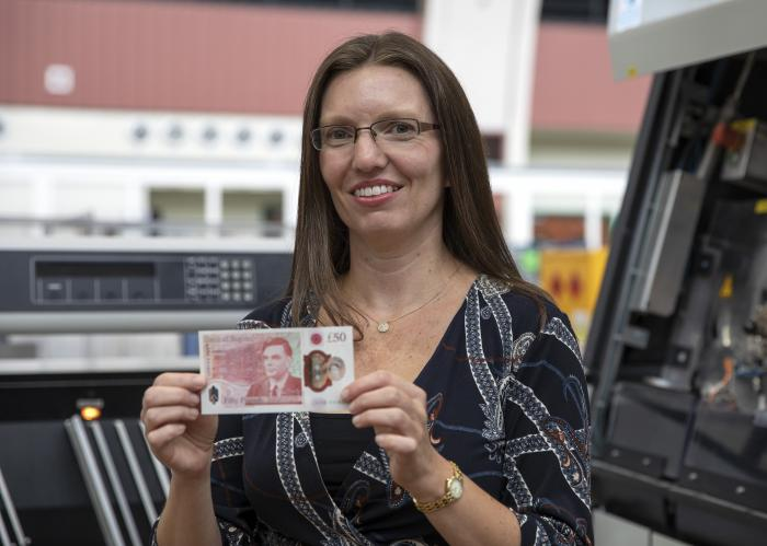 Sarah John, Chief Cashier at the Bank of England, holds the new 50-pound note featuring scientist Alan Turing.